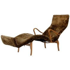 """A super comfortable and beautifully made lounge chair with a sheepskin cover. Designed by Bruno Mathsson in 1944. Made by Karl Mathsson, Sweden. Signed """"BM 44"""""""