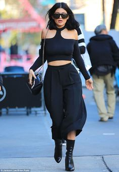 The sidewalk is her runway: The youngest Jenner girl teamed a halter-neck top with some culottes