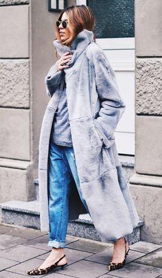Maja Weyhe of Maja Wyh looking street chic in distressed boyfriend jeans, a long plush coat and leopard kitten heel sling-backs