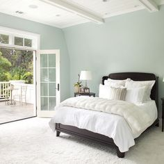 Benjamin Moore Woodlawn Blue - this is it! White bedding, cork floor, walls and trim like this