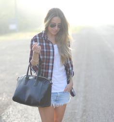 plaid shirt - opened over a well-fitted tee