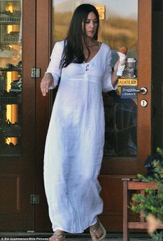 Ethereal: Monica Bellucci looked positively goddess-like as she stepped out on a grocery run wearing a sheer white maxi-dress while holidaying on the Greek island of Paros