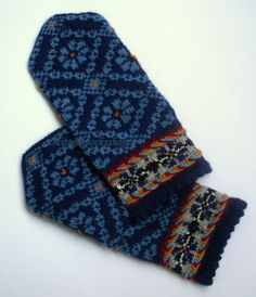 Wool mittens Hand knitted warm latvian mittens rustic winter gloves Light blue floral ornament on a dark blue background Blue black yellow