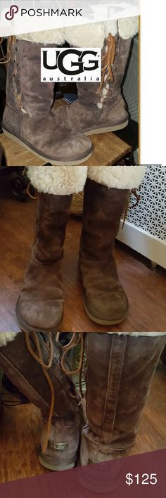 Fab Rawhide side Ugg boots 10 I am going to put up several parents and I scarcely wore these. Hard for me to pull boost up so I am keeping mostly the ankle ones. These are super warm and lined with shearling all the way down. Minimal normal wear no original box. They are like a light Cocoa Brown. UGG Shoes