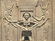 Relief showing a woman of ancient Egypt, giving birth. The goddess Hathor, protector of women during childbirth, assists on either side
