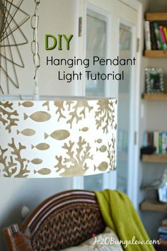 Tutorial to show how to make a simple stenciled DIY hanging pendant light from a drum lampshade, a chain and a light conversion kit. Easy DIY.