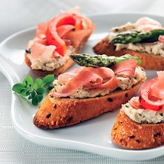 Crostini Aperitivo | Meals.com - Buon appetito! Add a touch of elegance to any gathering with this tasty Crostini Aperitivo appetizer. Topped with prosciutto and a delicious goat cheese and pesto spread, you've never experienced Tuscany like this before.