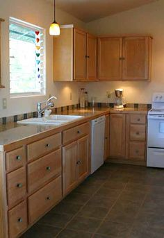 Kitchen Designs, The Astonishing Soft Brown Furniture With A Simple And Natural Sensation In A Kitchen: Kitchen Sink Lighting Is A Great Discovery