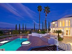 new Encino, CA house offered for sale. Price ~4mln will buy you a posh house 5br+ with lush view, pool, spa, cabana, done inside and out:)