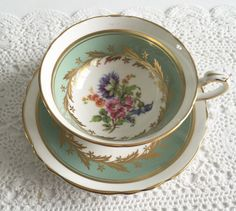 Vintage Paragon china tea cup and saucer, made in England. A beautiful sage green cabinet duo, with lots of gold gilding. It is in good condition, no chips, cracks or crazing. Please Note: The items I sell are not new, they are vintage or antiques, it goes without saying that there maybe some imperfections which I will try my best to point out and take pictures of. I do not look at my items under a microscope, but I do the best I can to describe it. Please ask questions, what maybe import...