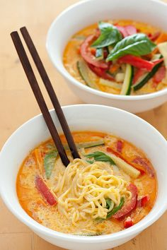 veggie laksa (coconut milk noodle soup) - 3/4lb (350g) fresh Singapore noodles, 2oz (60g) Laksa paste or other Thai curry paste, 1 large can (1 1/2 cups) coconut cream, 2 cups mixed chopped vegetables, handful fresh basil leaves