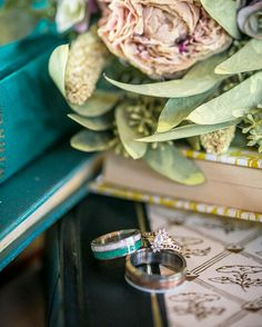 The beauty of rings books and flowers. Beautiful #vintagebooks by @twomonkeysvintage great shoot at @lodgewedding with a wonderful group from rising tide society