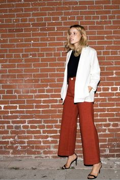 Wide-leg culottes are paired with a white blazer and simple tee for a look of effortless glamour.