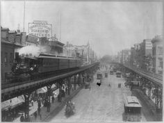 """Steam train on the Third Ave El, over the Bowery 1896.  The famous (and infamous) New York City neighborhood known as the Bowery has rustic roots, it's name a derivation of the Dutch term """"bouwerie,"""" which means """"farm."""" But it has historically been a raffish area that more often resembled a funny farm. The above classic photograph shows the Bowery in 1896."""