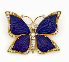 A carved lapis lazuli and diamond butterfly brooch, Nardi - signed Nardi; estimated total diamond weight: 1.15 carats; mounted in eighteen karat gold; length: 1 3/4in.