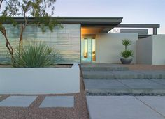 Desert Courtship - Custom Home Magazine. Deep overhangs help shade the main entry while a corrugated galvanized steel wall doubles as privacy screen and backdrop for an elevated planting area. Deep, shallow steps draw people in from all directions.