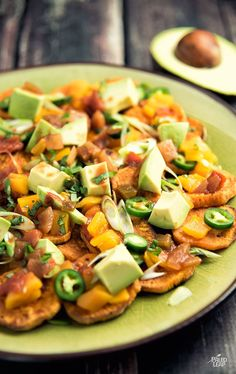 Missing nachos? Try this Paleo interpretation: crispy slices of sweet potato loaded down with flavor-packed toppings.