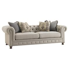Button-tufted sofa with down cushioning and matching accent pillows.  Product: SofaConstruction Material: Fabric...