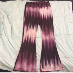 Boho hippy chic rayon tie dyed comfy bell bottoms Very chic. Very boho hippy cool with modern comfort and style. Rayon super soft tie dye purple. Design runs vertical which gives a flattering slim appearance. Super super comfy can be folded at top to shorten to wear with flip flops and slip on at beach over suit or leave long to wear with heels. You will be definitely stylin in these chic old school bell bottoms Pants Wide Leg