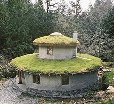 round house with cob exterior green roof