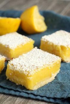 Perfect Lemon Bars - Best from scratch lemon bar recipe! dusted with powdered sugar on a shortbread crust. The best lemon dessert.
