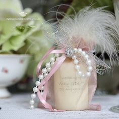 Crystal, lace and pearls wedding invitation is presented in a delicate organza bag {available in various colours}, the candle is decorated with lattice lace, pearls, a crystal clip and a fine feather {all available in different colours}. £3.99