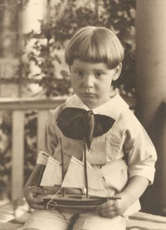 """Richard and his boat,"" age four or five, 1927-28."