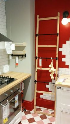 "A ""trick"" to save space in a small kitchen, from my last visit to IKEA. Use a ladder to be placed against the wall to create extra storage space. You can easily move the ladder if needed, and it's very convenient for hanging accessories or even food! Multifunctional Furniture, Diy Furniture, Extra Storage Space, Storage Spaces, Small Fireplace, Ikea Hackers, Diy Interior, Furniture For Small Spaces, Home Hacks"