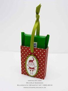 Schokifahrstuhl mit Anleitung. Eine bebilderte Anleitung, wie Du eine kleine Schokoladentafel (in diesem Fall eine Mini-Ritter Sport) originell verpackst.