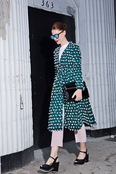 What WE'RE Wearing This Fashion Week  #refinery29 Love love love this H+M coat! Pink pants by Rachel Comey, shoes by Tory Burch, clutch by Dries Van Noten (bought on ebay a million years ago!)  http://www.refinery29.com/outfit-ideas-fashion-week-2014#slide1