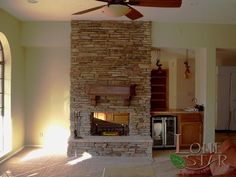 Interior fireplace with stacked stone in Phoenix, AZ. - www.lonestaraz.com