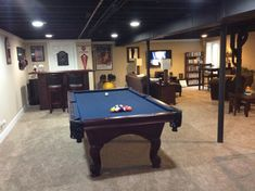 Loft-Like Basement, 800+ square feet - painted ceiling flat black, created rec area with pool table and dry bar, other side is media area/family room and childs play area.  , Basements Design