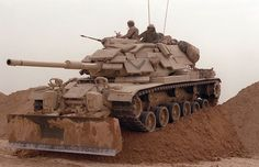 M60A1 with ERA. The venerable M60 was used by the US Marines in Operation Desert Storm in 1991. Upgraded with explosive reactive armor, the thirty year old tanks proved more than a match for supposedly more modern T-72s in the battles surrounding Kuwait City and the airport. Here, Marines from Company D, 2nd Tank Battalion, breech a sand berm in an M60A1 fitted with an M9 bulldozer kit.