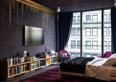 For a more urban option, check out this apartment bedroom from Alex Koretskiy. The gold wall treatment, with shimmering pain dripping down from the crown moulding and a contrast color of a lovely deep pink, create a urban sophistication for perfect sleep in the city.