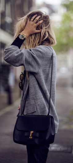Rebecca Laurey is wearing a grey jacket from Samsoe Samsoe and a bag from Delvaux