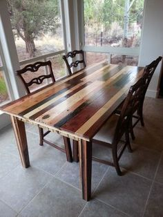 """The """"Jennifer"""" Dining Room Table - made from pallet wood - each slat stained a different color - via Ex Nihilo Furniture - which means """"out of nothing; from nothing."""""""