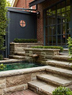 A miniature waterfall brings a spa-like feel to landscape designers Brad and Meredyth Hilton's urban garden.   Photographer: Virginia Macdonald