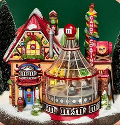 """Department Products - """"North Pole M&M's ® Candy Factory"""" - View Lighted Buildings Christmas Village Display, Christmas Village Houses, Christmas Town, Christmas Villages, Christmas Holidays, Christmas Decorations, Holiday Decor, Christmas Ideas, Grinch Christmas"""