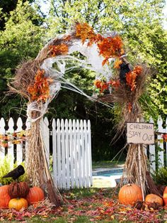For the entrance through the gate! Change theme from fall to Halloween...spiders and ghosts and bats...orange, black, purple, green...