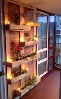 Focal Wall With Lights And Planters Made From Pallets | A Little Bit of This, That, and Everything