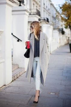 Love the big pale winter coat--with white pants.