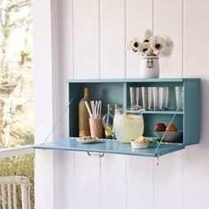 Discreet minibar!  This would be a great way to stash our booze and party glasses.
