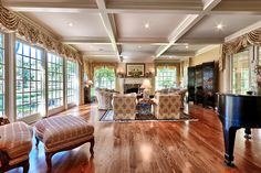 Traditional Living Room with Crown molding, Carpet, Hardwood floors, Box ceiling, stone fireplace
