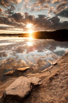 Autumn sky and setting sun are reflected in the waters of Algonquin Park's Lake of Two Rivers