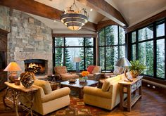 Warm and inviting sitting area by the #fireplace | Paula Berg Design Associates