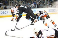 San Jose Sharks forward James Sheppard gets tripped up by Ben Lovejoy of the Anaheim Ducks (Jan. 29, 2015).