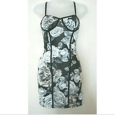 Corset Dress Size: M  Stretchable body-con material  Beautiful floral rose design  Adjustable shoulder straps  Built-in bra cups  Color: Black & white   Measurements:  Bust: 34 inches  Length (underarm to bottom hem): 26 inches  Waist: 26 inches   Brand new mystic Dresses