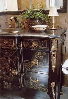 Beautiful black chinoiserie chest converted to an elegant powder room vanity.  Oh, but I hate to see antiques converted into something else, so I'll just wish for the the chinoiserie chest in its original state!
