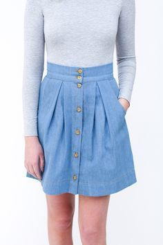 Kelly skirt sewing pattern / Button front pleated skirt with pockets. Pattern sits on the natural waist and features button front placket, wide waistband, large scoop pockets and pleating in the front and back.
