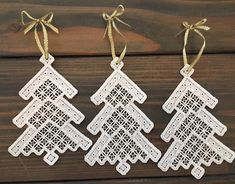 Beautiful white on white hardanger ornaments. They measure 5.25 from the tree top to bottom. And 3 across. You may also use them to finish off a wrapped gift.
